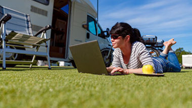 Relaxes woman using laptop on an RV