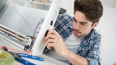 Man Examining a heater